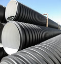 Sewer pipes pile of new large plastic Royalty Free Stock Photo