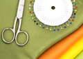 Sewing accessories scissors pins and fabric Stock Image
