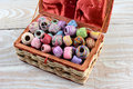 Sewing box filled with thread high angle shot of a a variety of embroidery threads in a wicker basket on a rustic wooden table Stock Image