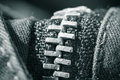 Sewing concept zipped zipper close up on black jeans in black and white Royalty Free Stock Photo