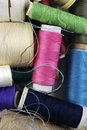 Sewing cotton in different colors packed and unpacked in plastic box Stock Images