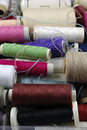 Sewing cotton in different colors packed and unpacked in plastic box Royalty Free Stock Photos