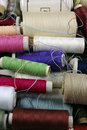Sewing cotton in different colors packed and unpacked in plastic box Royalty Free Stock Photo