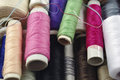 Sewing cotton in different colors packed and unpacked in plastic box Royalty Free Stock Images