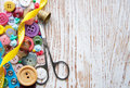 Sewing items stuff on a old wood background Royalty Free Stock Photo
