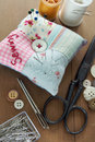 Sewing items with a vintage feel thread antique scissors pins and buttons Royalty Free Stock Photos