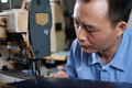 Sewing leather materials the worker in the factory Royalty Free Stock Photography