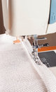 Sewing machine and decorative edging cord the process of a of white cloth Stock Photos