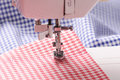 Sewing machine detail with the red thread and cloth Royalty Free Stock Photo