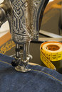 Sewing machine and item of clothing material vintage home measured tape scissors Royalty Free Stock Photos