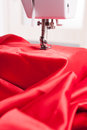 Sewing machine modern with red satin Stock Photography