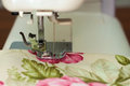Sewing machine needle and fabric Royalty Free Stock Photo
