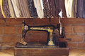 Sewing machine old under rack of rolls of tissue Royalty Free Stock Image