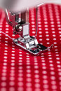 Sewing machine presser foot with threaded needle Royalty Free Stock Photo