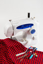 Sewing machine with red cloth Stock Image