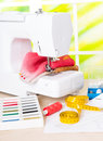Sewing machine and sewing accessories with colorful fabrics threads other accesories Stock Photography