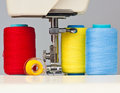 Sewing machine and  thread bobbins Royalty Free Stock Photo