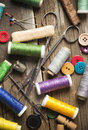 Sewing spools and buttons scissors and needles scattered Royalty Free Stock Images