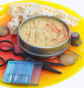 Sewing supplies and items on orange tray Royalty Free Stock Photo