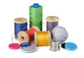 Sewing supplies thread spools needle thimble and buttons isolated on white Stock Photo
