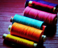 Sewing thread in atractive different colors Royalty Free Stock Image