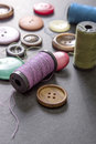 Sewing thread and buttons on table close up Stock Image