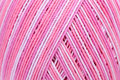 Sewing thread close up pink color in spool Royalty Free Stock Photo