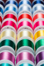 Sewing thread multi colored spools of background Royalty Free Stock Images