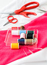 Sewing tools and colored tape sewing kit scissors bobbins with thread needles Royalty Free Stock Image