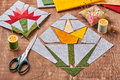 Sewing two patchwork blocks of flowers from quilt fabric Royalty Free Stock Photo