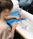 Sews on the sewing machine Royalty Free Stock Image