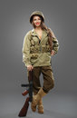 Sexual Girl soldier with tommy gun. Royalty Free Stock Photo