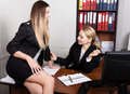 Sexual harassment. female boss sexually molested the female employee Royalty Free Stock Photo