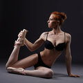 Sexual red haired ballerina posing in lingerie black Royalty Free Stock Photos