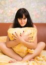 Sexual young woman in a bed with pillow Royalty Free Stock Images