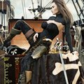 adult female pirate with long brown hair enjoying her newly acquired treasure aboard her pirate ship.