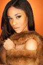 Sexy African American fashion model wearing fur Royalty Free Stock Photo