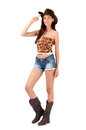 Sexy american cowgirl with shorts and boots and a cowboy hat isolated on white background Royalty Free Stock Image