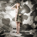 Sexy army girl saluting on snow camo background camouflage winter fashion Stock Photos