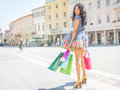 Sexy asian girl with shopping bags walking in the city center Royalty Free Stock Photo