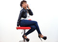 Sexy Asian woman in black leather jacket and leggings Royalty Free Stock Photo
