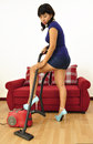 Sexy Asian woman short dress doing house chores Royalty Free Stock Photo