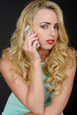 Sexy Attactive Young Woman Using a Mobile Telephone Royalty Free Stock Photo