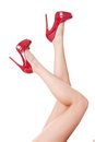 Sexy bare female legs in elegant red stilettos Royalty Free Stock Photo