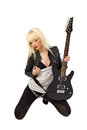 Sexy beautiful blonde girl posing with guitar Royalty Free Stock Photos