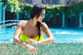 Sexy beautiful girl in bikini at the pool in the hotel. Summer v Royalty Free Stock Photo