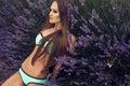 Sexy beautiful girl with long hair in bikini posing at lavender fashion photo of woman straight dark mint field Stock Image