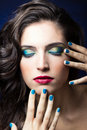 Sexy beauty girl with red lips and blue nails make up portrait of Royalty Free Stock Image