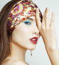 Sexy Beauty Girl with Red Lips and Nails. Provocative Make up. Luxury Woman with Blue Eyes. Fashion Brunette Portrait