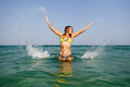 Sexy bikini girl happy jump sea waves splash Royalty Free Stock Photo